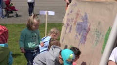Kids with parents draw on paper wall. 4K Stock Footage