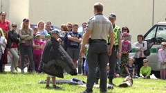 Policeman give child to try protective jacket from dog bites . 4K Stock Footage