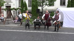 Folk band members play live folklore music. 4K Stock Footage