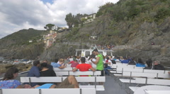 Tourists on a sightseeing boat's deck in Cinque Terre Stock Footage