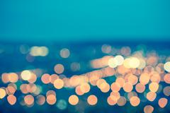 Abstract blue circular bokeh background, city lights with horizon, toned styl Stock Photos