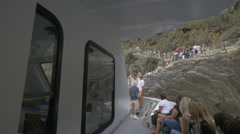 Boat with tourists arriving to the seashore in Riomaggiore, Cinque Terre Stock Footage