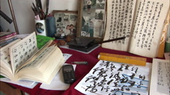Chinese calligraphy, desk, cellphone, photos - stock footage