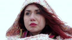 Thoughtful young woman, redhead, detail of her suffering face Stock Footage