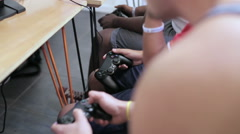 Boys use controllers to play video game - stock footage
