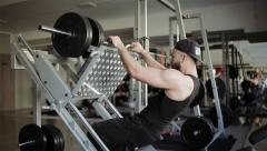 Man workout with simulator platform in the gym Stock Footage