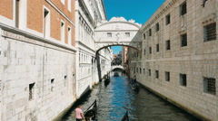View of a venetian canal in the lagoon, gondoliers, bridge Stock Footage