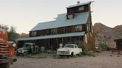 Eldorado Canyon mine tour. Old barn with retro cars Stock Footage