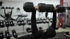 Man dumbbells workout in the gym - stock footage