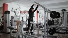 Man workout with Hammer Strength in the gym Stock Footage