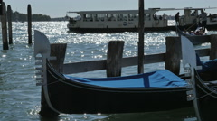 Classic gondola sways in the lagoon of Venice, sea, boats Stock Footage