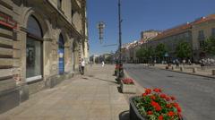 Walking on Krakowskie Przedmiescie street, near the Holy Cross Church, Warsaw Stock Footage