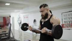 Man training barbell in the gym Stock Footage