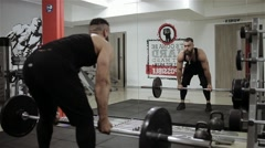 Man workout rod in the gym Stock Footage