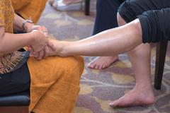 Reflexology foot massage in Thai spa treatment Stock Photos