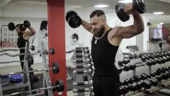 Man dumbbells workout in the gym Stock Footage