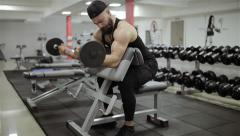 The man takes barbell and workout in the gym Stock Footage
