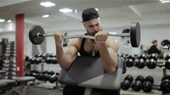 The man workout barbell in the gym Stock Footage