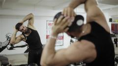 A man warming up in the gym Stock Footage