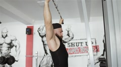 Man workout with power simulator in the gym Stock Footage