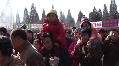 Stock Video Footage of Chinese kids sitting on fathers shoulders
