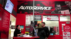 Auto service counter inside Canadian tire store Stock Footage