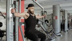 Man workout with Peck-Deck in the gym Stock Footage