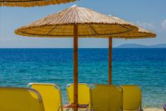 Summer ,Holiday, Travel, Vacation concept ,Sunshade and Chairs on the Sandy T Stock Photos