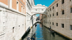 Three Gondolas in the canal, bridge, Venice, city of lovers Stock Footage