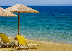Summer ,Holiday, Travel, Vacation concept ,Sunshade and Chairs on the Sandy T - stock photo