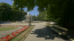 Statue and fountain in the Saxon Garden in Warsaw Stock Footage