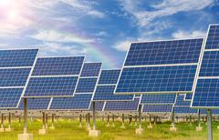 Stock Photo of Power plant using renewable solar energy with blue sky
