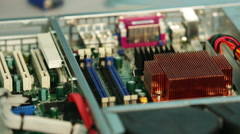 Closeup of Installing RAM memory module into server motherboard. - stock footage