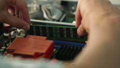 Installing RAM memory module into server motherboard, Closeup. - stock footage