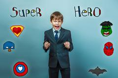 boy businessman he clenched fists and shouts angry superhero sup - stock photo