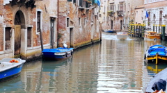 Tourist boat sailing fast in a Venetian canal - venice Stock Footage