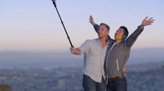 Man Raises His Arms In Air, Kisses His Boyfriend For Selfies With Gopro Stick Stock Footage