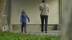 Slow motion, people entering underpass - stock footage