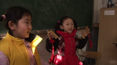 Chinese schoolgirls, reciting & clapping - stock footage