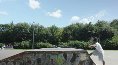 4K Young man practicing parkour jumps at the skate park.  Stock Footage