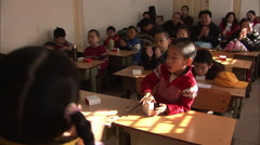 Chinese kids clapping hands in class Stock Footage