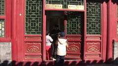 Traditional Chinese red door, children Stock Footage