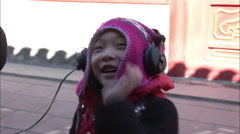 Chinese girl playing with sound equipment Stock Footage