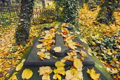 A gravestone at old cemetery in autumn - stock photo