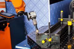 Robot welding process Stock Photos