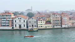 View of venetian palaces taken from a boat sailing the lagoon, architecture Stock Footage
