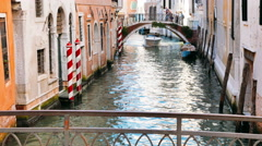 A boat sailing in a Venetian canal - venice Stock Footage