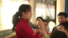 Chinese kids, schoolroom, teacher, Beijing Stock Footage