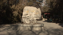 Chinese writing on a rock, Beijing park Stock Footage