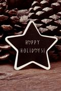 star-shaped chalkboard with the text happy holidays - stock photo